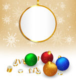 Christmas balls with streamers and frame on beige Royalty Free Stock Image