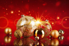 Christmas balls. In the sun on a red background Royalty Free Stock Image