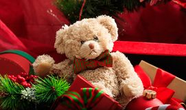 Christmas balls, teddy bear and gifts royalty free stock photos