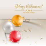 Christmas balls. Three variety Christmas balls lying on crumpled cloth Stock Photography