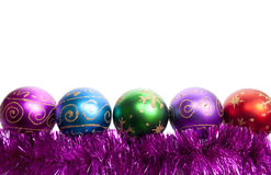 Christmas balls and tinsel. New-year decorations. Varicoloured Christmas balls and tinsel on a white background Stock Photography