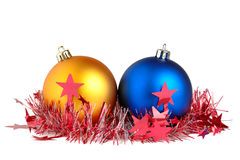 Christmas balls and tinsel Stock Photos