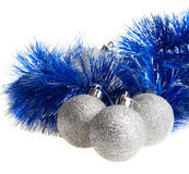 Christmas balls and tinsel Stock Images