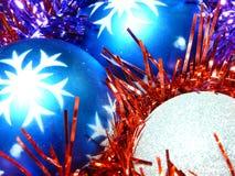 Christmas balls in tinsel Royalty Free Stock Photos