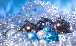 Christmas balls in tinsel Royalty Free Stock Photography