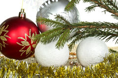 Christmas balls with tinsel and fir branch as a background Stock Images
