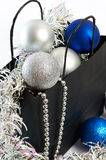 Christmas balls and tinsel in gift bag symbol of New Year isolat Royalty Free Stock Image