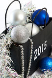 Christmas balls and tinsel in gift bag symbol of New Year isolat Royalty Free Stock Photos