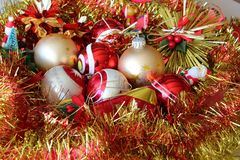 Christmas balls and tinsel. Red and golden Christmas balls and tinsel of different sizes Royalty Free Stock Photos