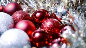 Christmas balls and tinsel to decorate the house. Colorful garla. Christmas balls and tinsel to decorate the house. r Royalty Free Stock Image