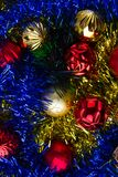 Christmas balls in tinsel. Christmas tree balls are in a multicolored tinsel Royalty Free Stock Image
