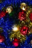 Christmas balls in tinsel. Royalty Free Stock Image