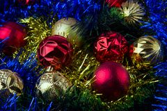 Christmas balls in tinsel. Christmas tree balls are in a multicolored tinsel Stock Image