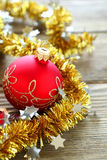 Christmas balls with tinsel on a wooden boards Royalty Free Stock Photography