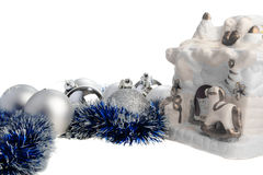 Christmas balls and toy fireplace Stock Photography