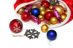 Christmas balls, toys in bag on white Stock Images