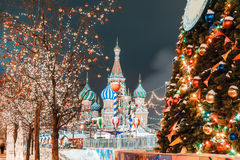 Christmas balls on tree branches in Red square Stock Photos