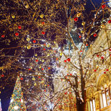 Christmas balls on tree branches in Red square Royalty Free Stock Photo