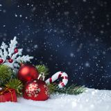 Christmas balls with tree and decorations on snow stock photography