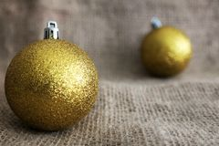 Christmas balls. Two christmas balls on a burlap surface Royalty Free Stock Photo