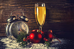 Christmas balls and vintage clock with glass of champagne Stock Photography
