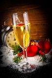 Christmas balls and vintage clock with glass of champagne Royalty Free Stock Photos