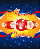 "Christmas balls are visible through the hole in the dark blue sky formed by the words ""Merry Christmas"". Christmas and New Year bright colorful Royalty Free Stock Photography"