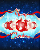 Christmas balls are visible through the hole in the dark blue sky formed by the words `Merry Christmas`. Christmas and New Year colorful background Royalty Free Stock Images