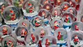 Christmas balls with water inside and Santa Claus Stock Photography