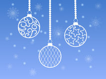 Christmas balls. White Christmas balls on a blue background with snowflakes royalty free illustration