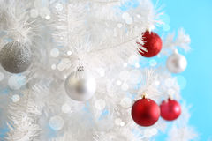 Christmas balls on the white Christmas tree Stock Photography
