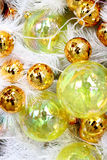 Christmas balls on white feathers Royalty Free Stock Images