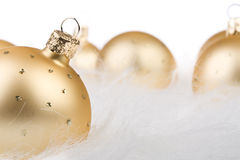 Christmas balls in white fur Stock Images