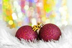 Christmas balls on white fur Stock Photo