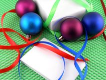 Christmas balls, white gift box, white invitation card Stock Photography