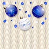 Christmas balls on white knitted pattern Stock Photo