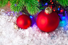 Christmas balls on white snow with branch fir tree Royalty Free Stock Images