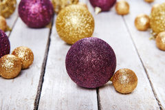 Christmas balls on white table stock photos