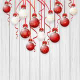 Christmas balls on white wooden background Royalty Free Stock Image