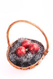 Christmas balls in a wicker basket on a tinsel Stock Photography