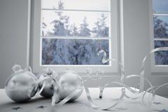 Christmas balls and window Royalty Free Stock Photography