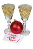 Christmas balls and wineglasses Royalty Free Stock Image