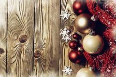 Christmas balls on wood Stock Photos