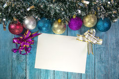 Christmas balls on a wooden background Stock Photography
