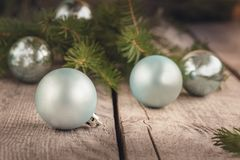 Christmas balls on wooden background with branches of spruce. Decoration. Stock Photography