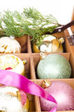 Christmas balls in wooden box Royalty Free Stock Images