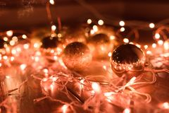 Christmas balls with a garland of coral color. royalty free stock image
