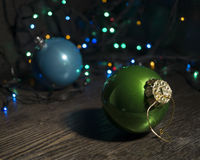 Christmas balls. Christmas balls on wooden table with lights Stock Photos