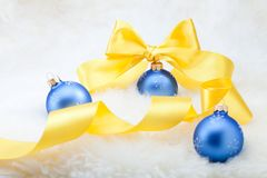 Christmas balls with yellow ribbon bow Royalty Free Stock Photos