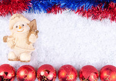 Christmas bals and snowman on snow. Christmas background - snowman and christmas balls  on snow Royalty Free Stock Photography